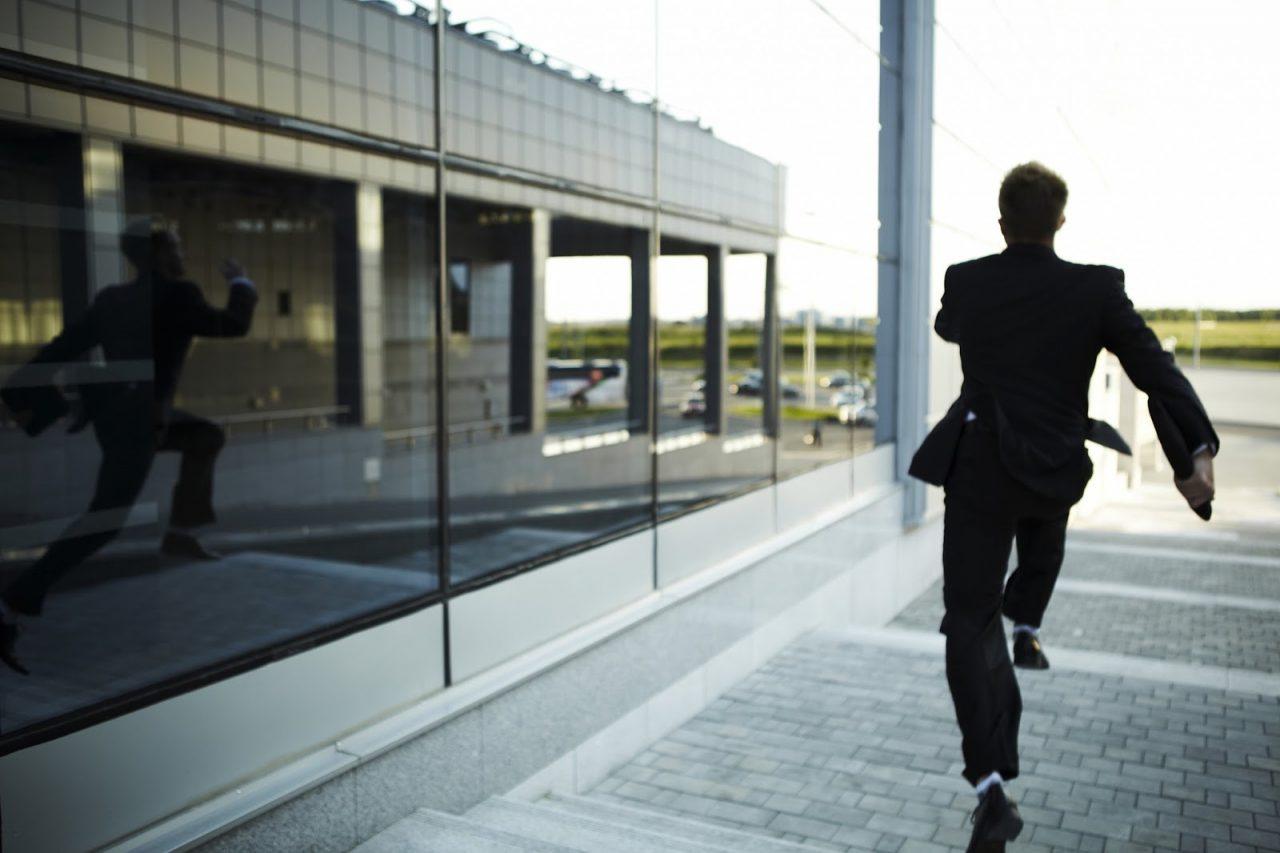 man running away fleeing scared courtesy of InnervisionArtshutterstockcom_57811195