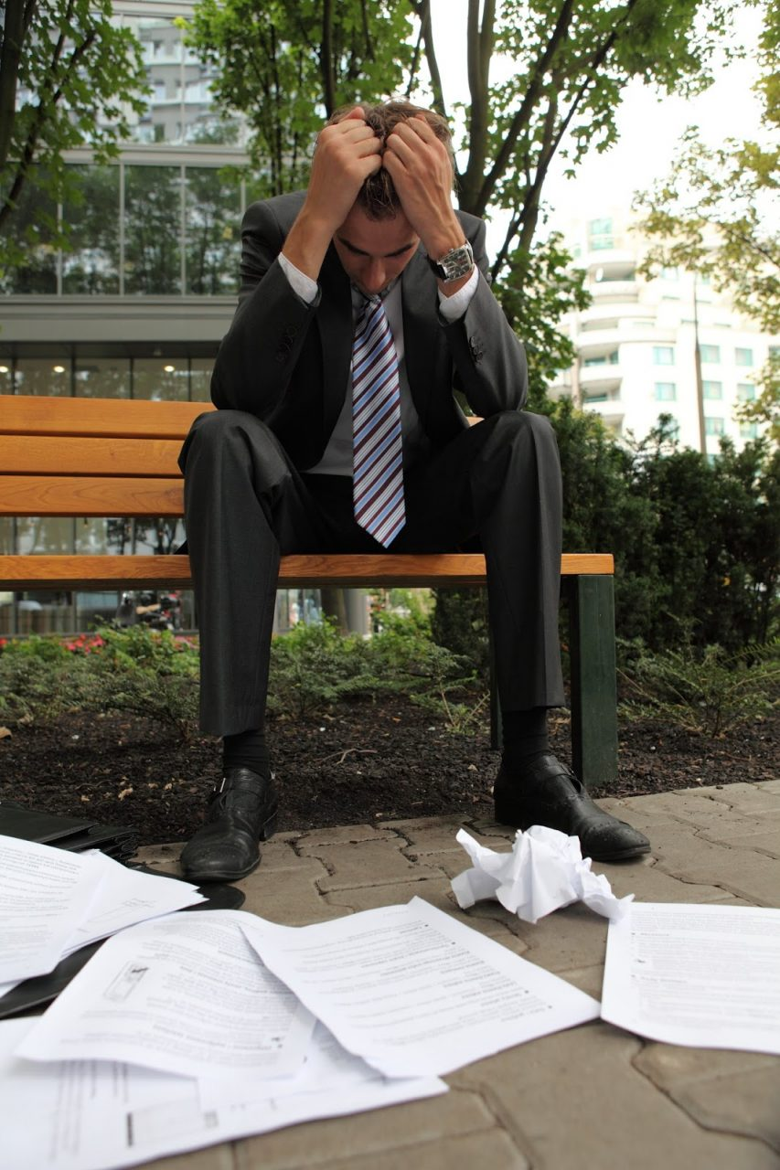 young businessman stressed papers fallen anxierty frustrated Courtesy of bikeriderlondonShutterstockcom_274189832