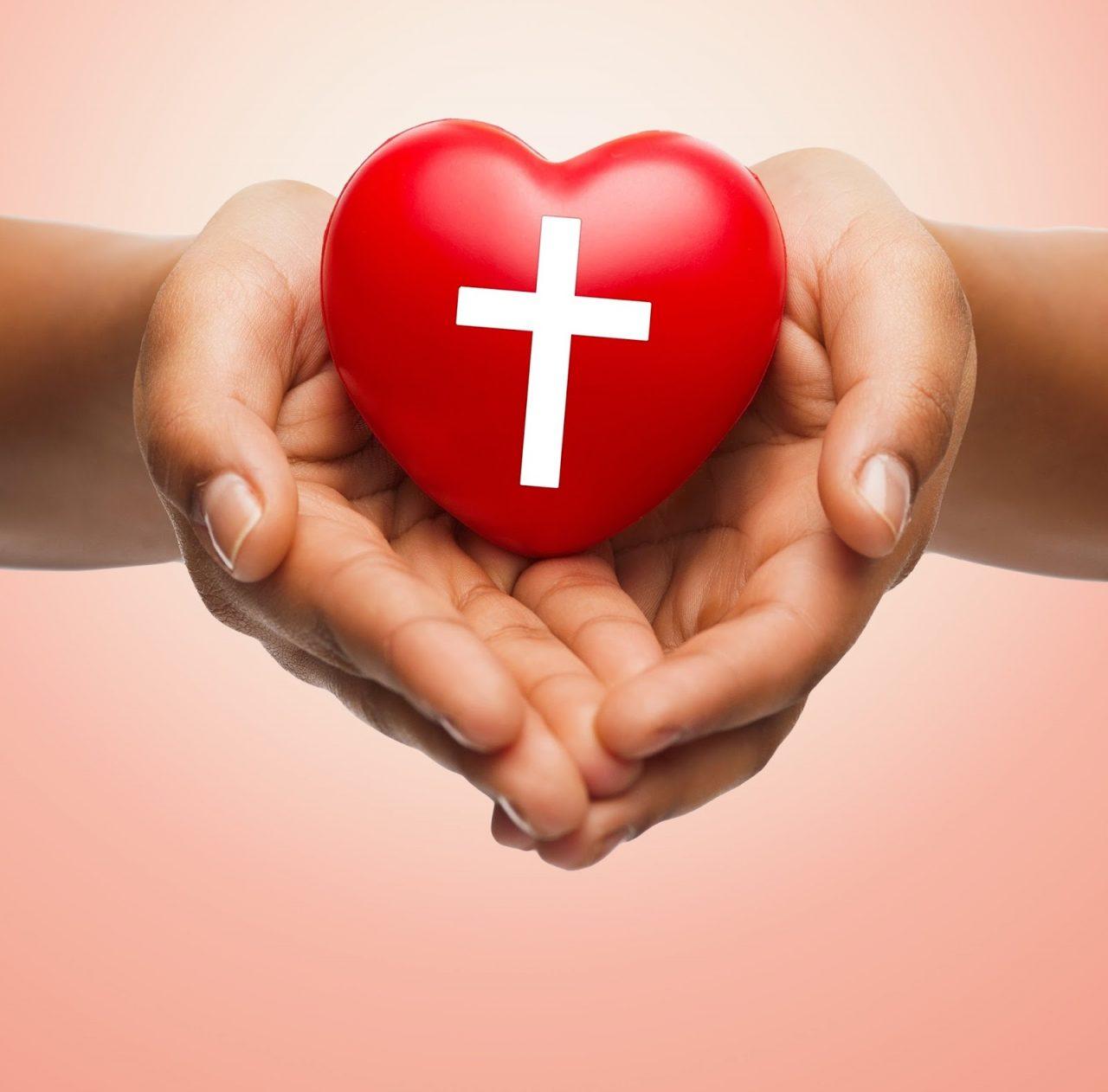 holding heart cross Courtesy of Syda ProductionsShutterstockcom _280428407