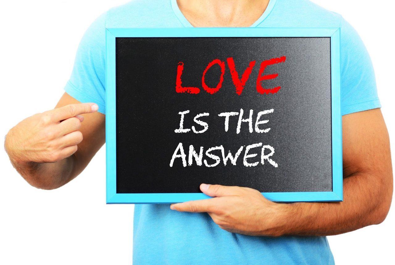 man in tshirt pointing at chalkboard love is the answer Courtesy of Aleksandar MijatovicShutterstockcom _222655099