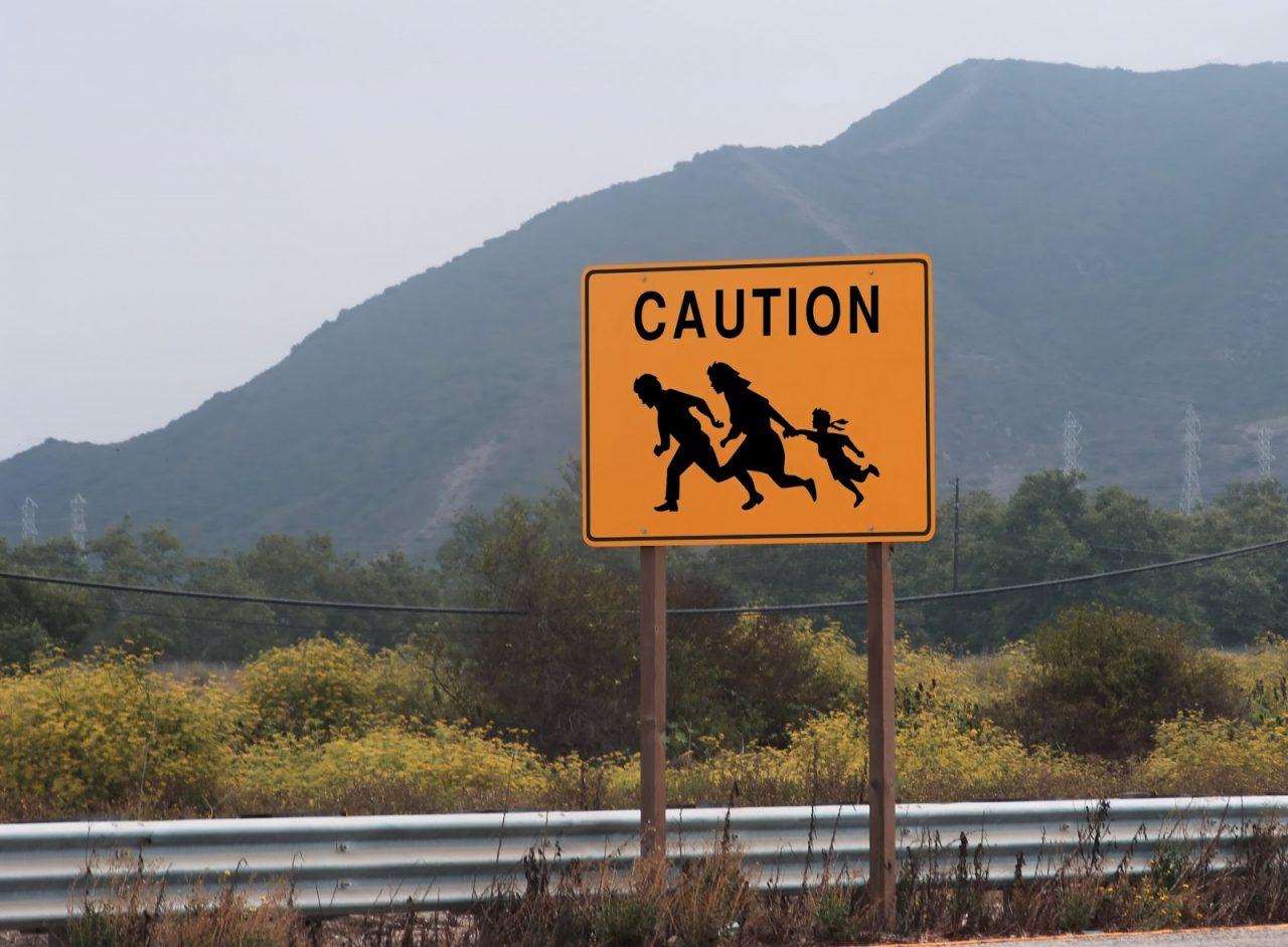 border crossing immigrants road sign Courtesy of James Steidl Shutterstockcom_1755945