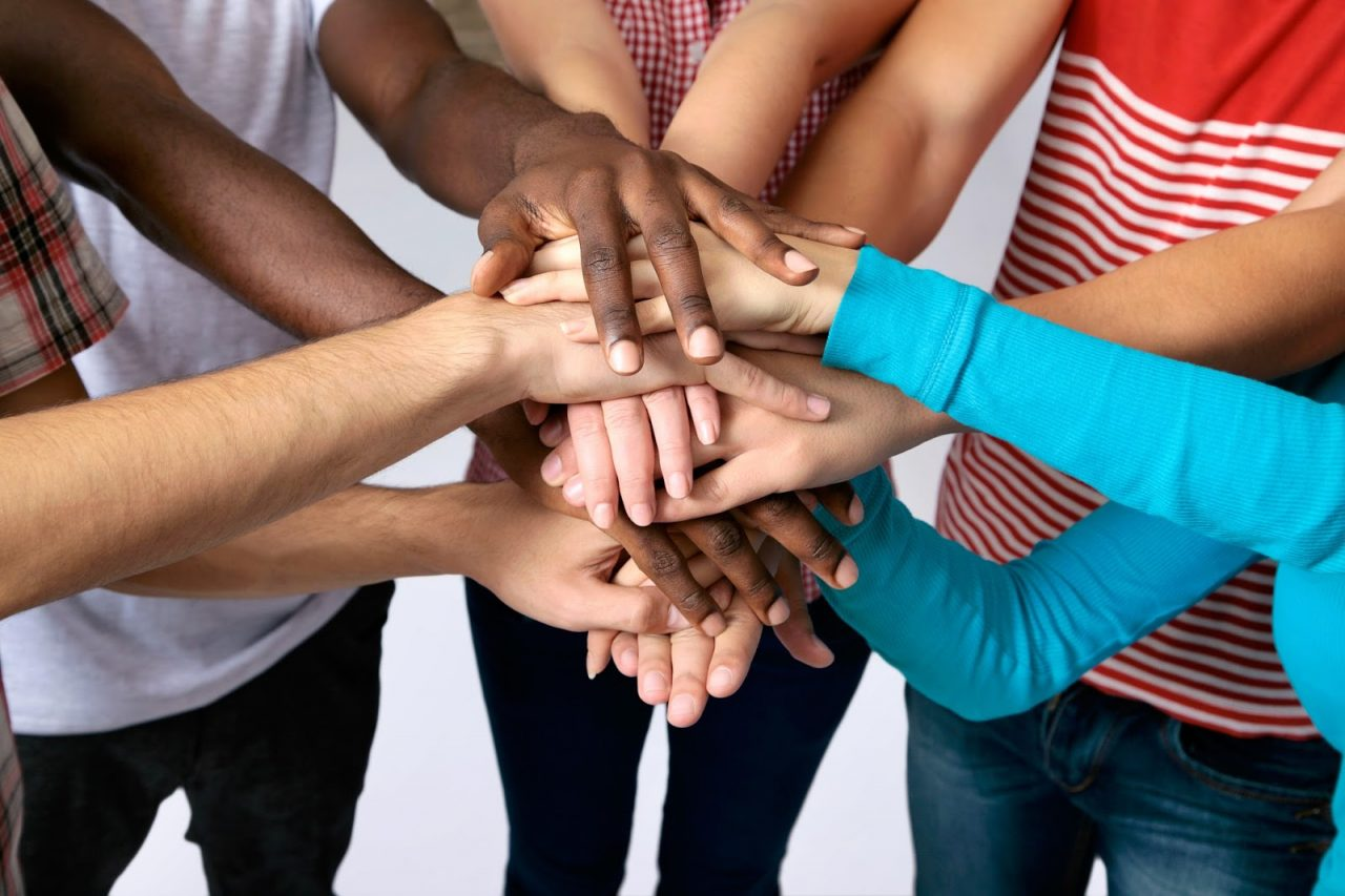 multi ethnic hands coming together in center Courtesy of Konstantin ChaginShutterstockcom _113484922