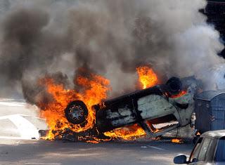 burning car riots division anger strife anger mob demonstration shutterstock com bibiphoto_137895923